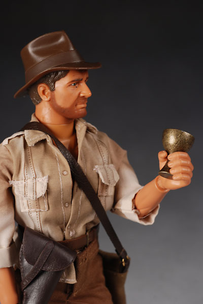 Indiana Jones action figure and Monopoly Holy Grail